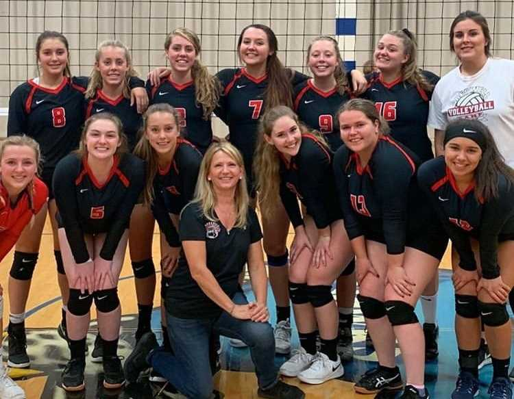 Creswell's volleyball team poses with coach Anna Baltrusch after her 500th win. (Photo courtesy Creswell High School)
