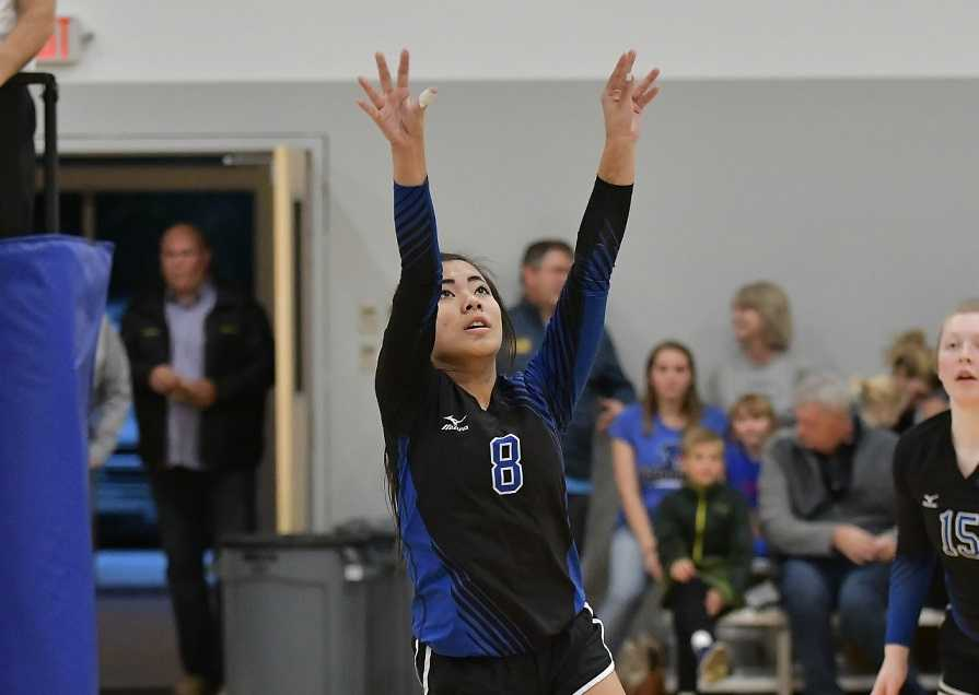 Willamette Valley Christian's Delaney Barnes sets against Falls City. (Photo by Andre Panse)