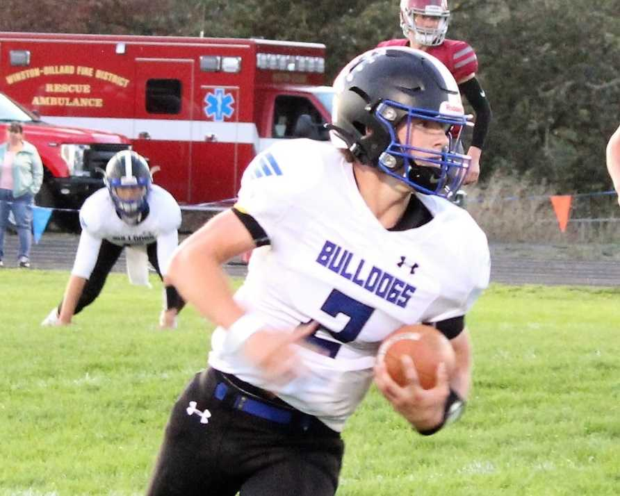 Senior running back Case Wells is a key blocker in Sutherlin's wing-T offense. (Photo by Wade Wells)
