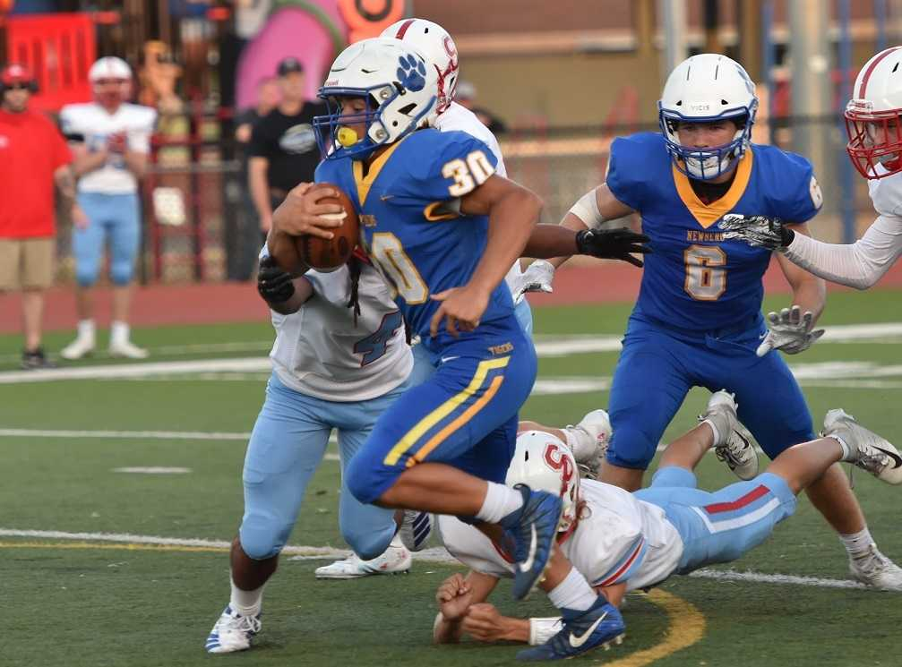 Newberg sophomore fullback Price Pothier has rushed for 986 yards this season. (Photo by Dean Takahashi)