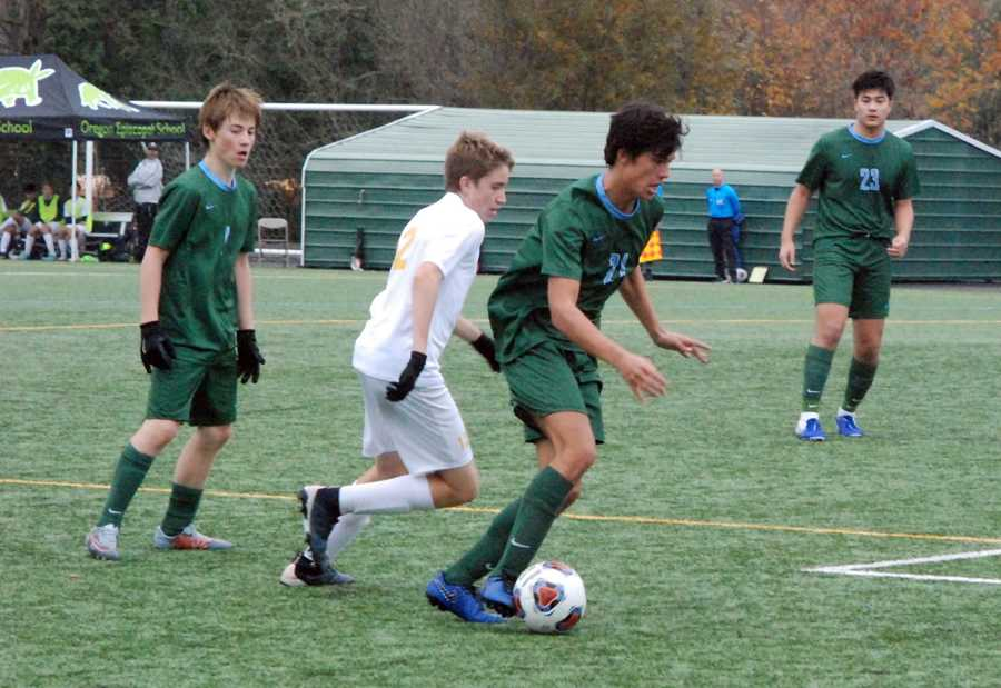 Alex Ugas (21) possesses the ball for OES against the challenge of Dylan Hodge. Patrick Ruoff (1) and Jonah Song look on