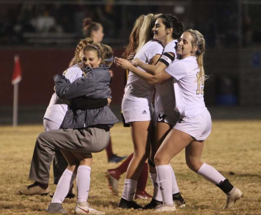 Marist Catholic players celebrate their win over North Valley. (Photo by Kevin Cave)