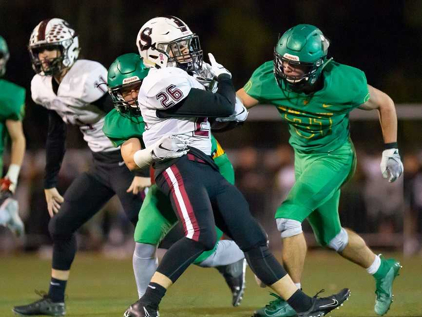 Sherwood's Brody Stevens fights for yards against West Linn on Oct. 4. (Photo by Brad Cantor)