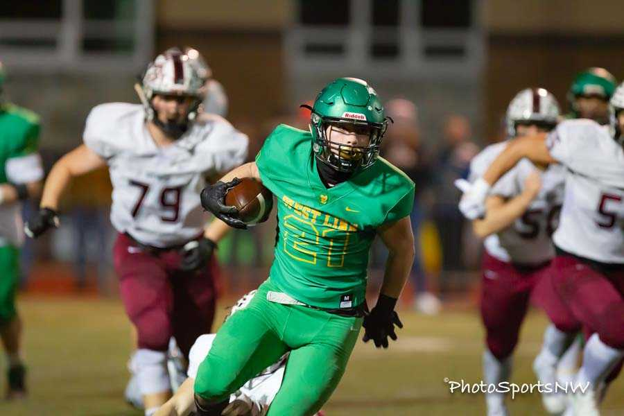 Gavin Haines ran wild for West Linn in its 21-point home win over Sherwood. Photo by Brad Cantor