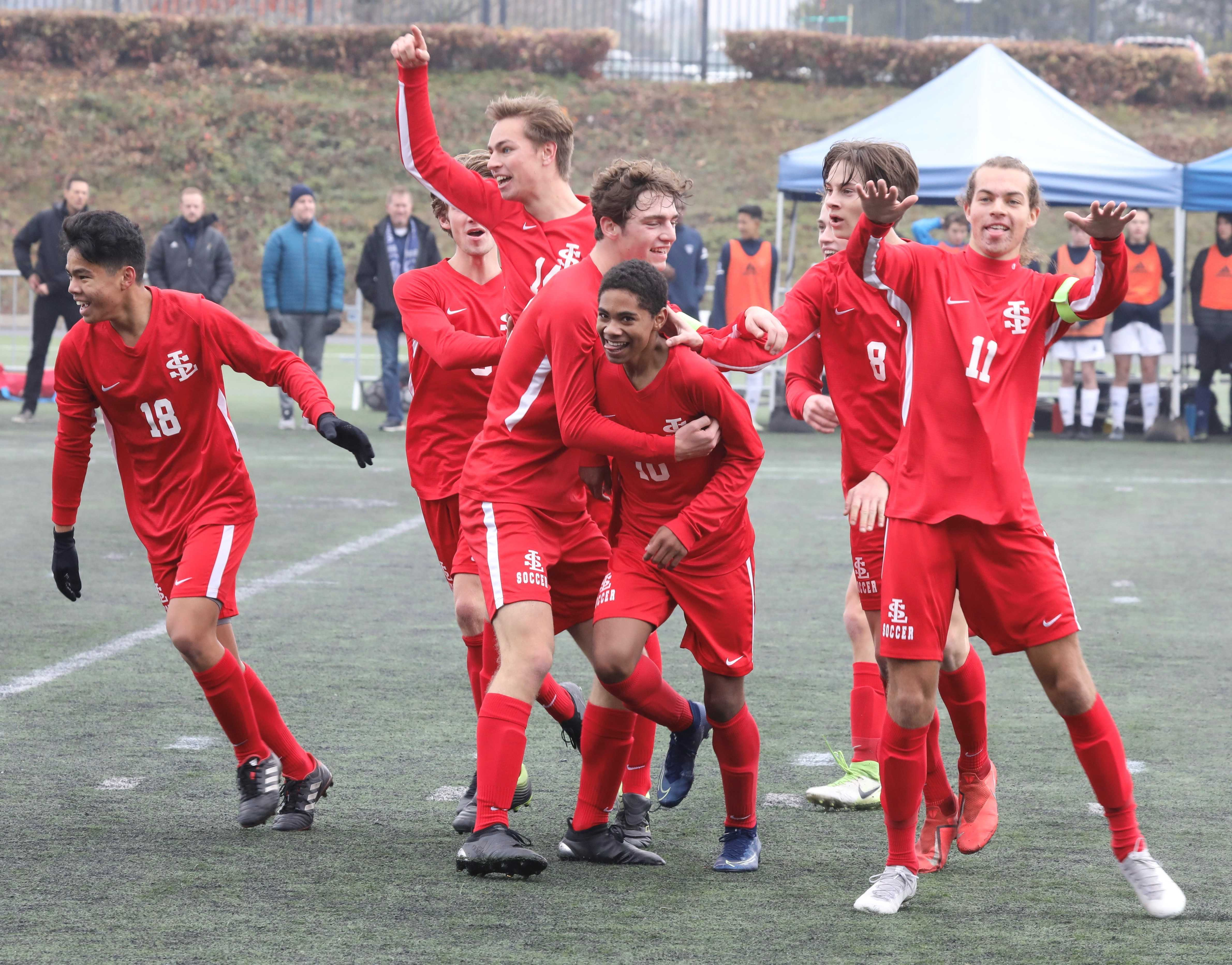La Salle Prep's Mizael Harris (10) celebrates the first of his two goals Saturday. (Photo by Norm Maves Jr.)
