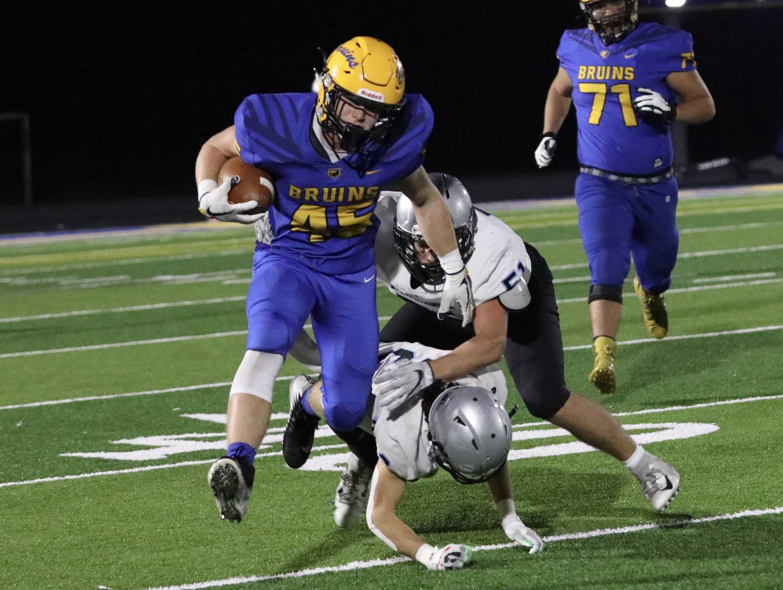 Barlow's Andrew Collins evades two Mountainside tacklers on his way to a 40-yard run on a screen pass. (Norm Maves Jr.)