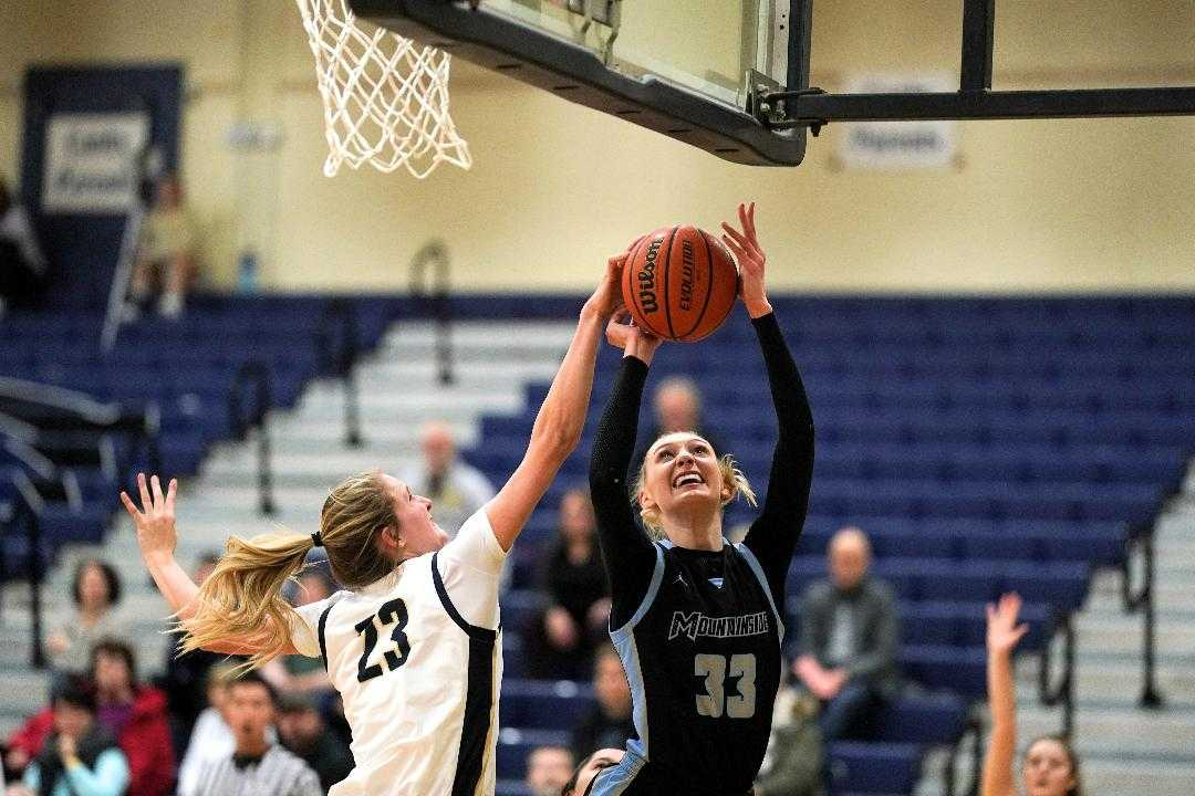 Canby's Nicole Mickelson (23) blocks Mountainside's Cameron Brink (33) on Tuesday night. (Photo by Jon Olson)