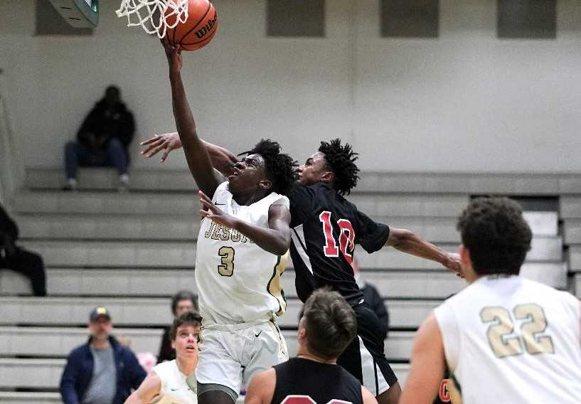 Jesuit's Roy Bunn (3) goes up for two points against Clackamas' KJ Horsley. (Photo by Jon Olson)