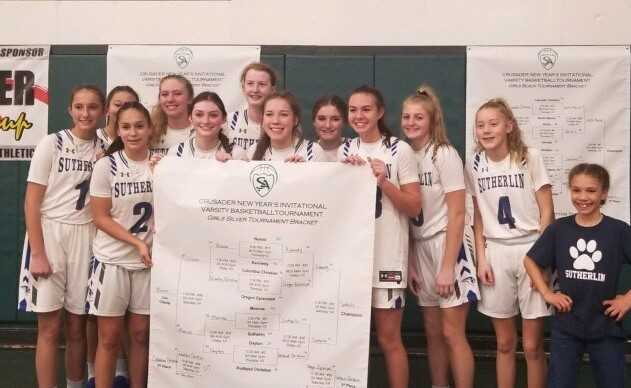 Sutherlin poses with the tournament bracket after winning the Crusader Classic New Year's Invitational.