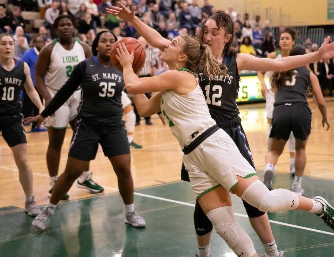 West Linn's Cami Fulcher shoots against St. Mary's Academy's Anny Eddy on Friday. (Photo by Gene Schwartz)