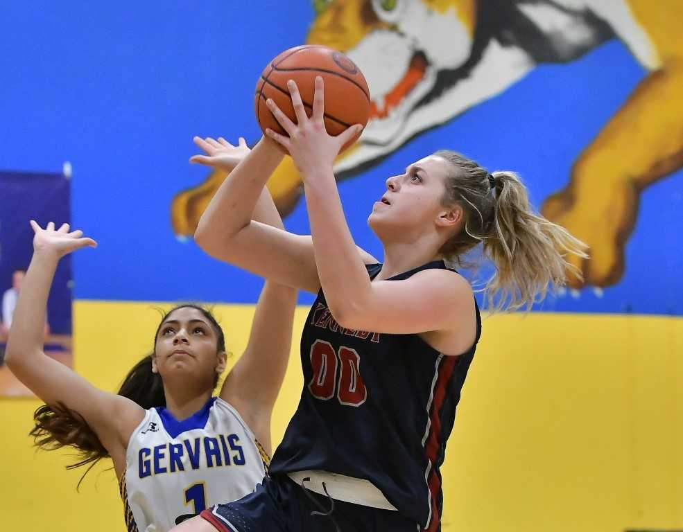 Kennedy's Sophia Carley shoots over Gervais' Celi Vasquez on Friday night. (Photo by Andre Panse)