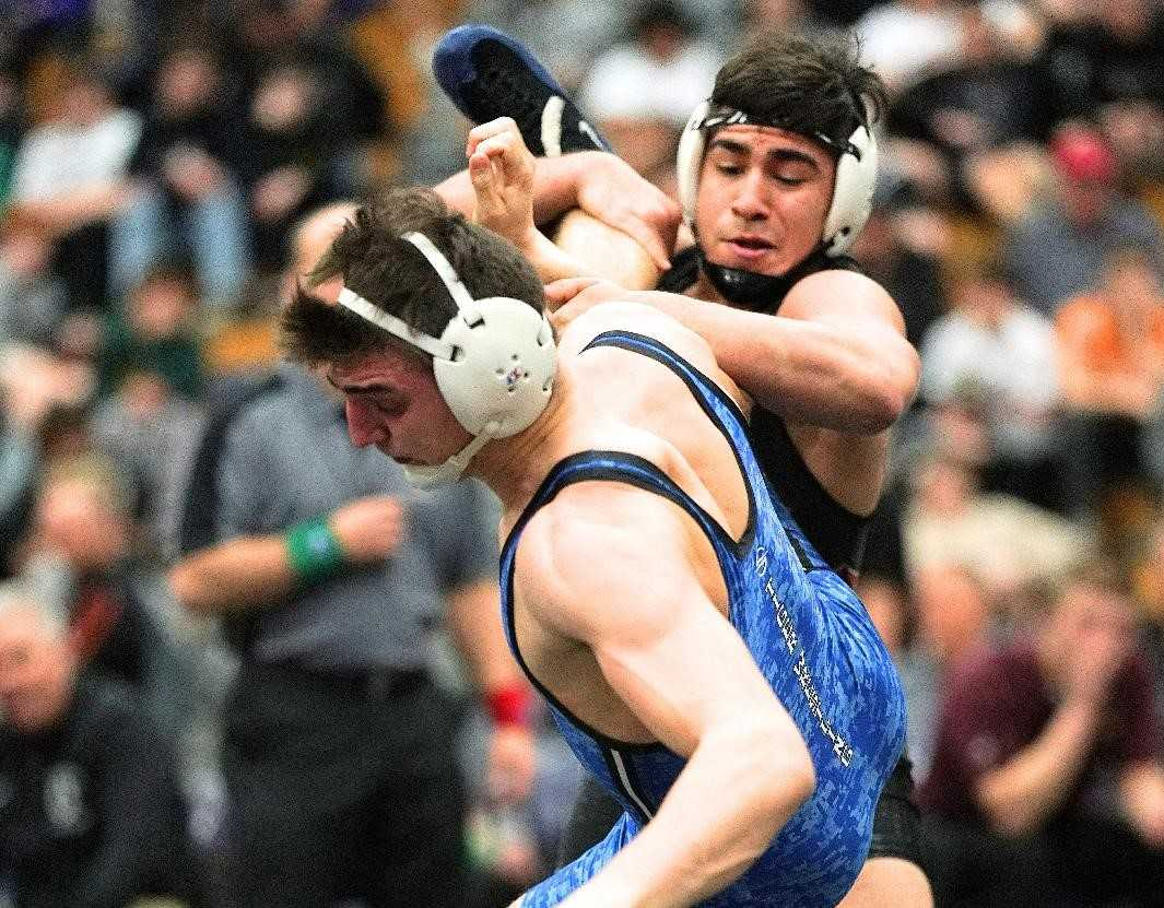 Crescent Valley's Santos Cantu (right) works against La Grande's Christopher Woodworth on Saturday night. (Photo by Jon Olson)