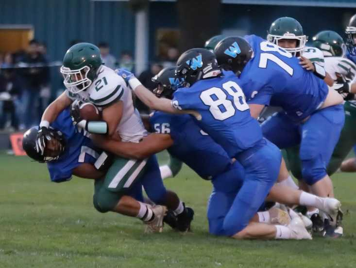 Woodburn's defense smothered North Marion, holding the Huskies to 91 yards.