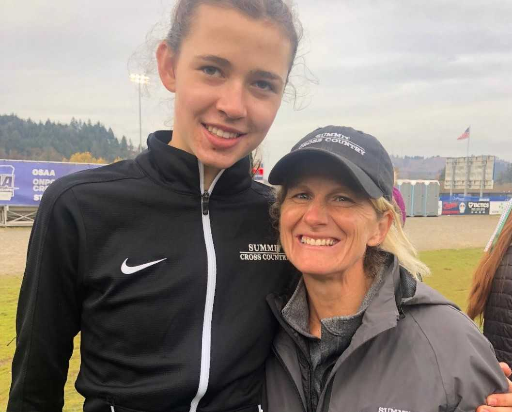 Kari Strang (right) is counting on junior Teaghan Knox to help lead the 12-time reigning state champion Storm girls team.