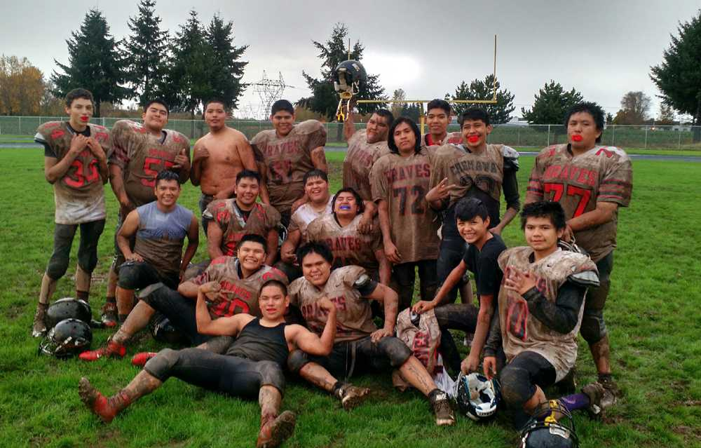 This photo was taken during the winless '16 season. Muddied and bloodied, they still played and practiced hard and with smiles.