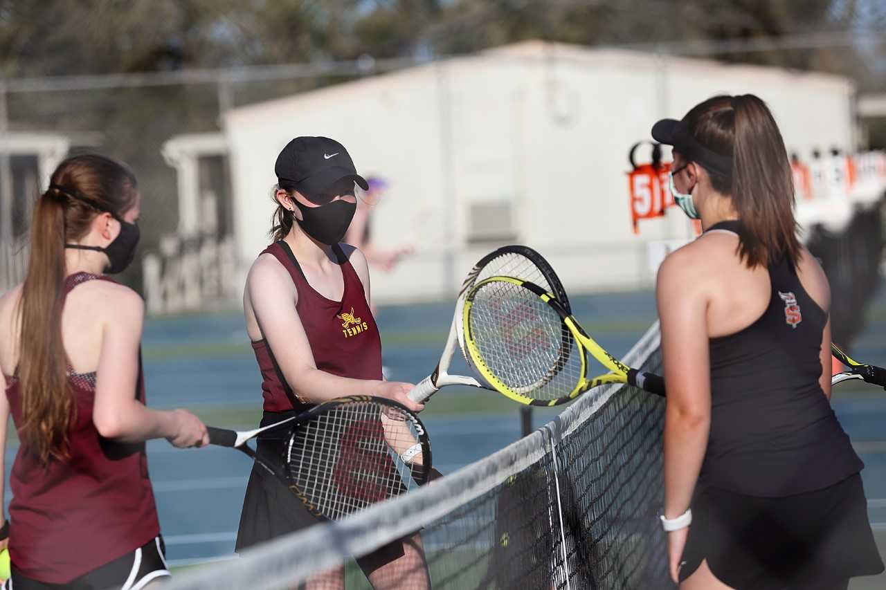 Crescent Valley (left) and Sprague (right) girls doubles teams meet in a match this month. (Courtesy Crescent Valley HS)