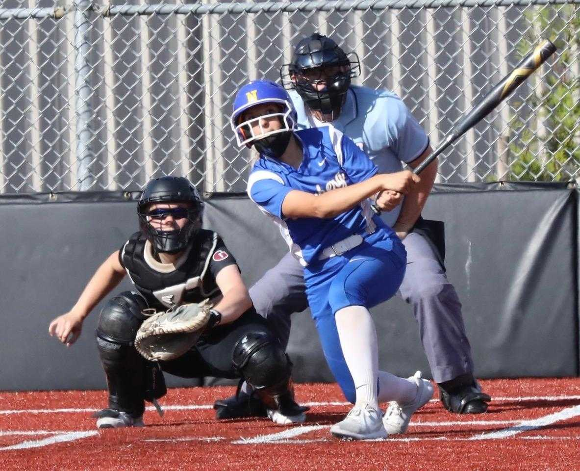 Newberg's Abby Carsley, homering Monday at Glencoe, has eight home runs and 28 RBIs. (Photo by Norm Maves Jr.)