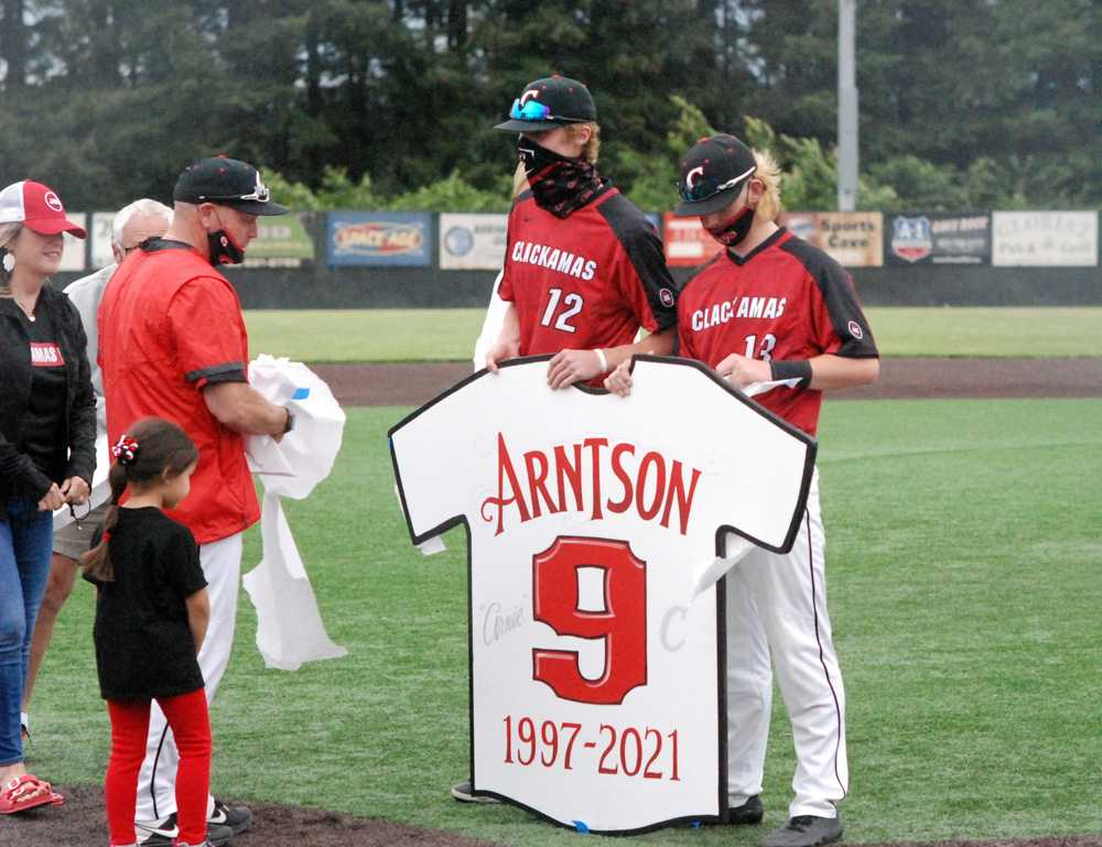 J.D. Dorn (12) and K.C. Miller held coach John Arntson's retired jersey initially.