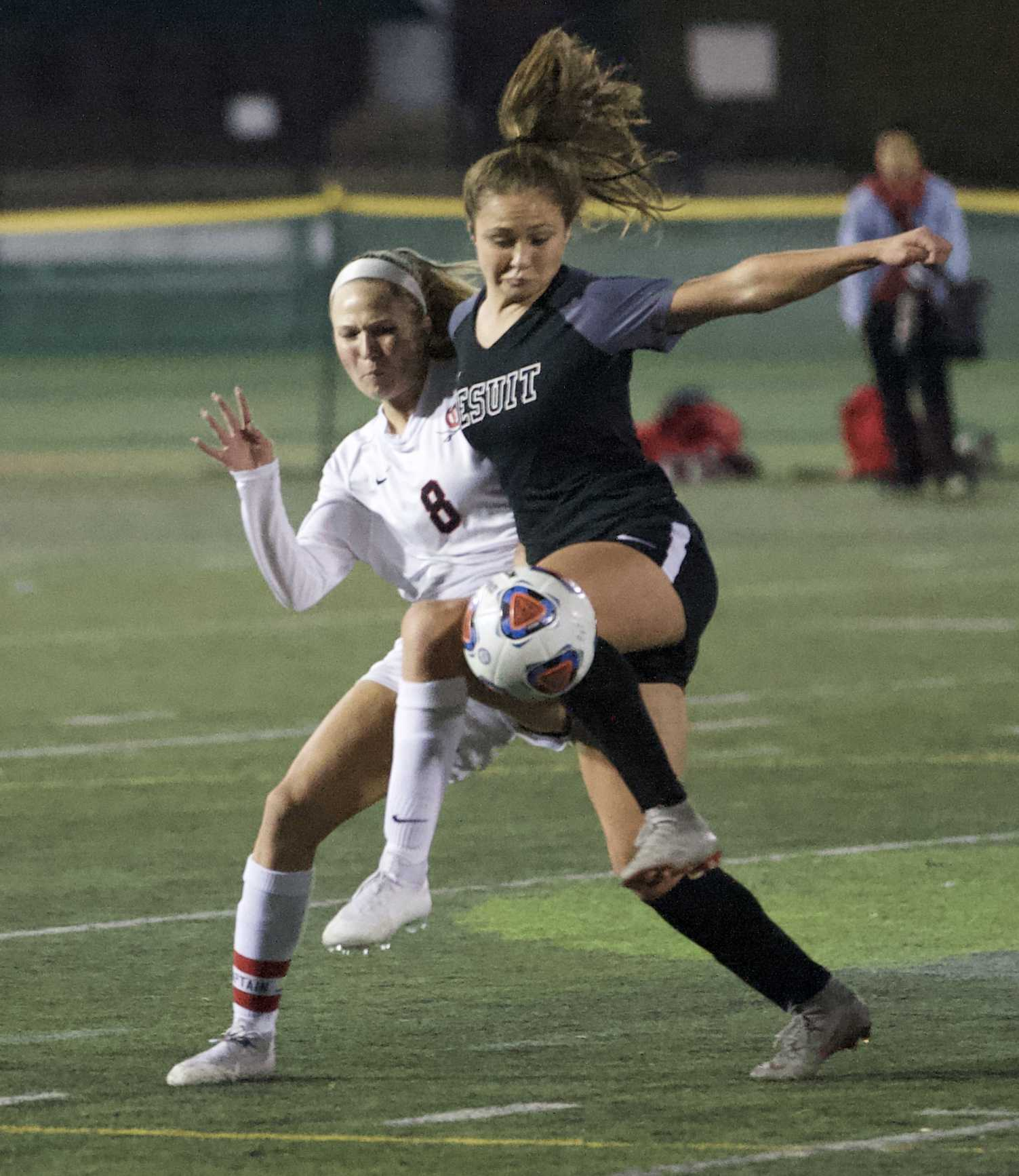Jesuit's Callan Harrington battles with Clackamas forward Madeline Tetz for a ball at midfield. (Photo by Norm Maves Jr.)