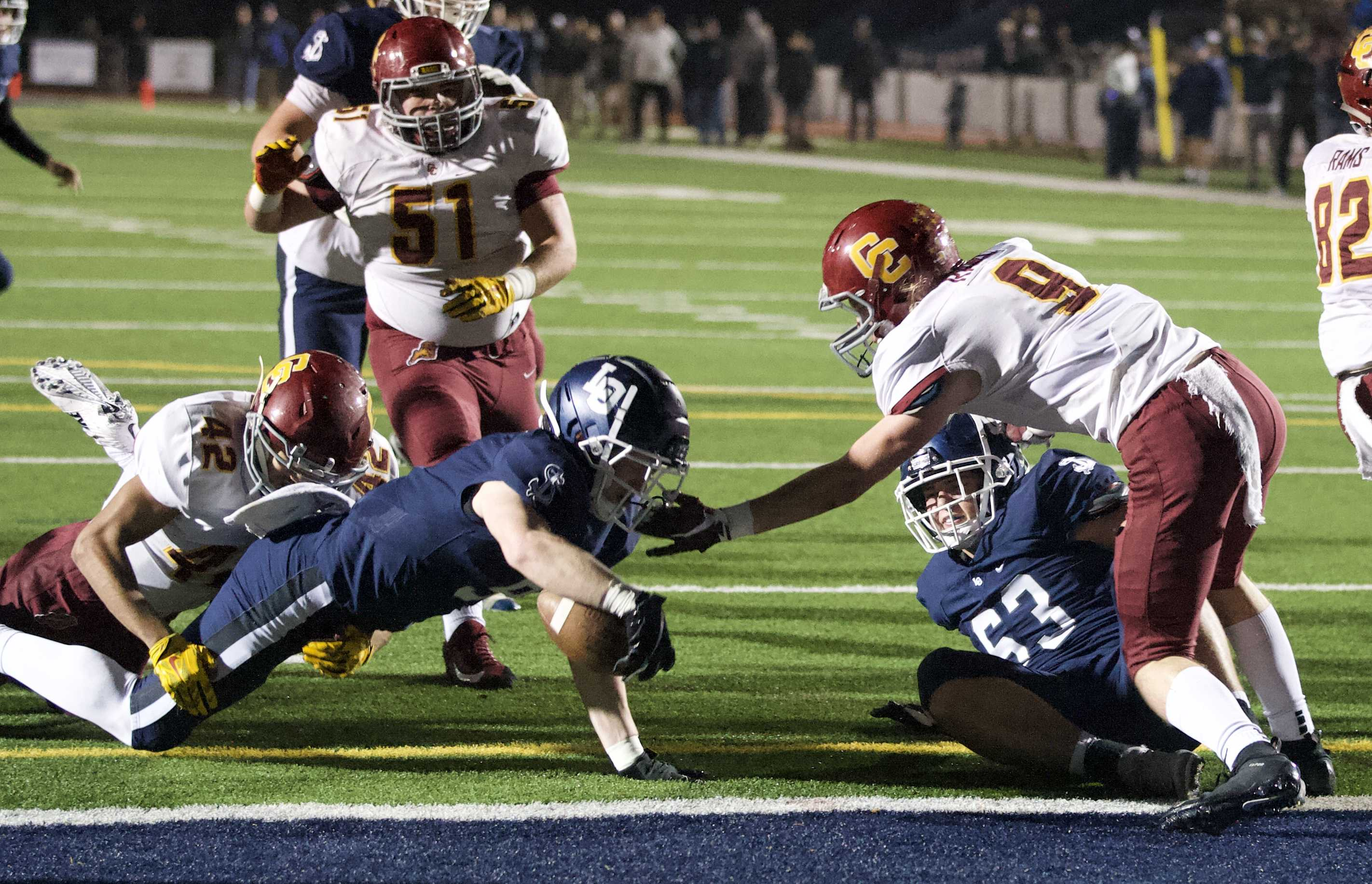 Casey Filkins scores the first of his three touchdowns in Lake Oswego's win Friday. (Photo by Norm Maves Jr.)
