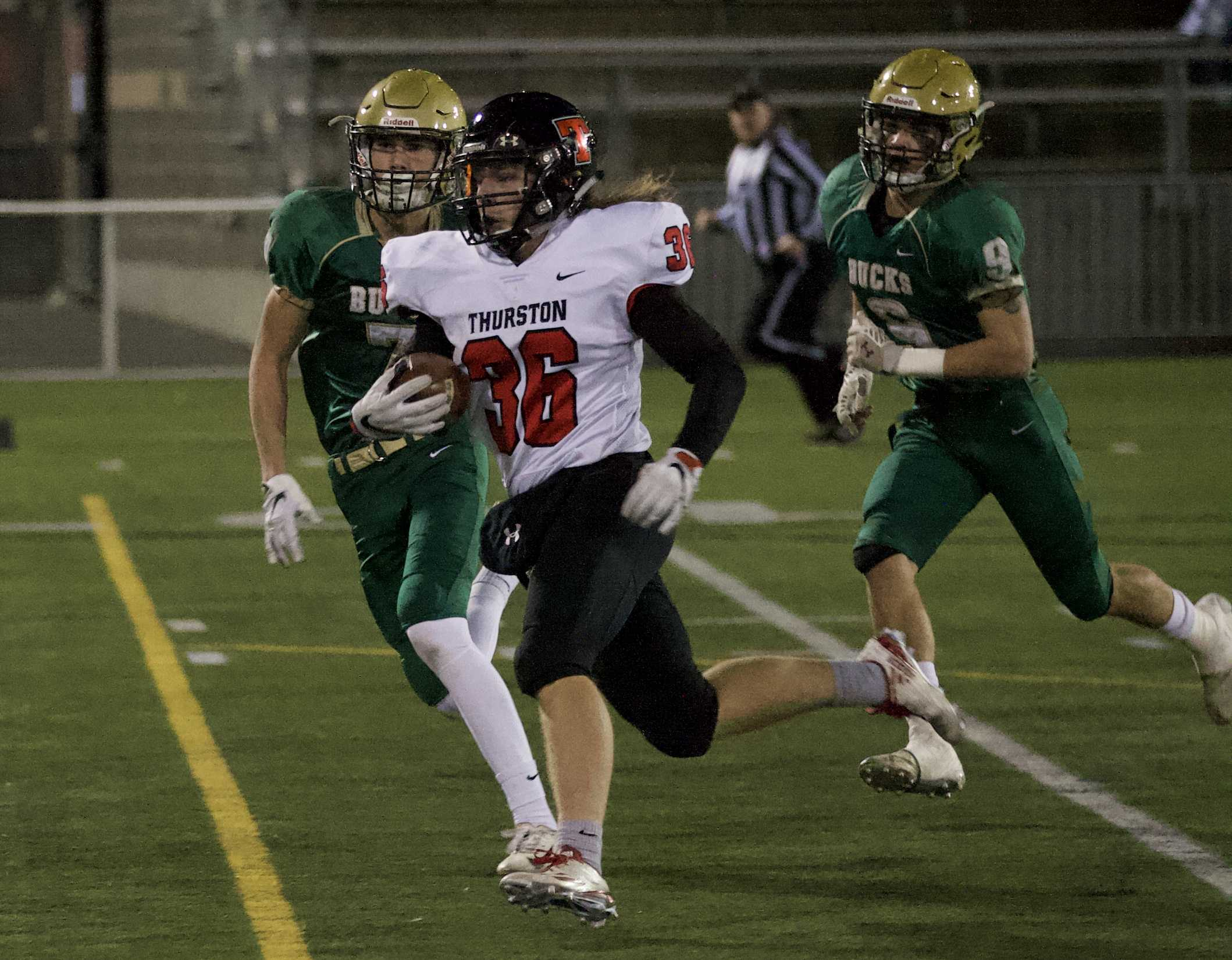 Thurston's Wesley Kommer (36) ran for 150 yards and two touchdowns in the first half Saturday night. (Photo by Norm Maves Jr.)