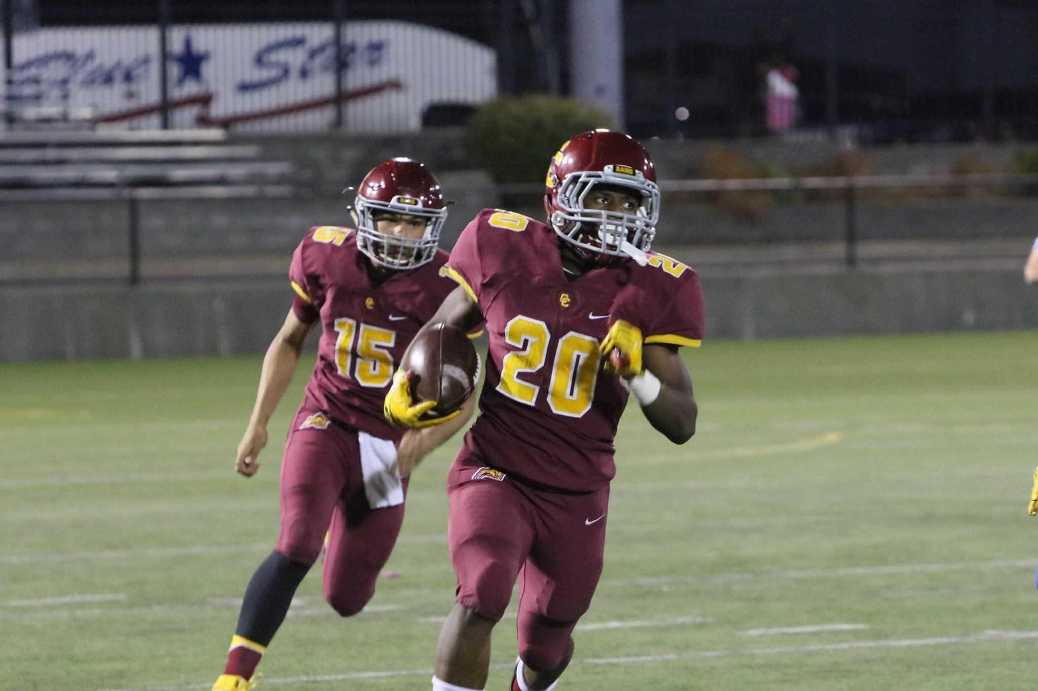 Running back Elijah Elliott (20) and quarterback Cade Knighton (15) will help lead the Rams in 2018. (Photo by Jim Nagae)