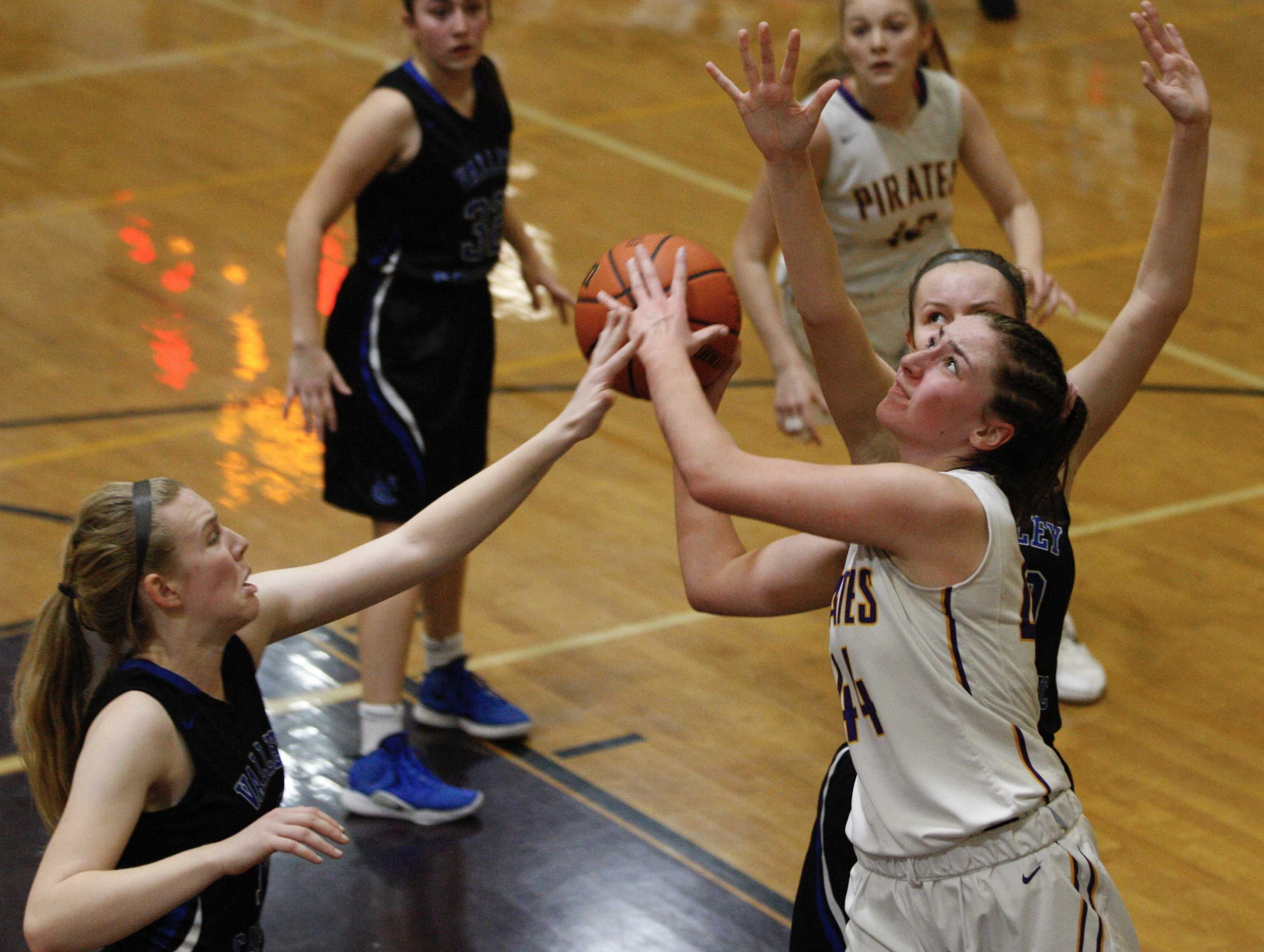 Marshfield's Alex Locati slices between two Valley Catholic defenders for two of her 12 points.