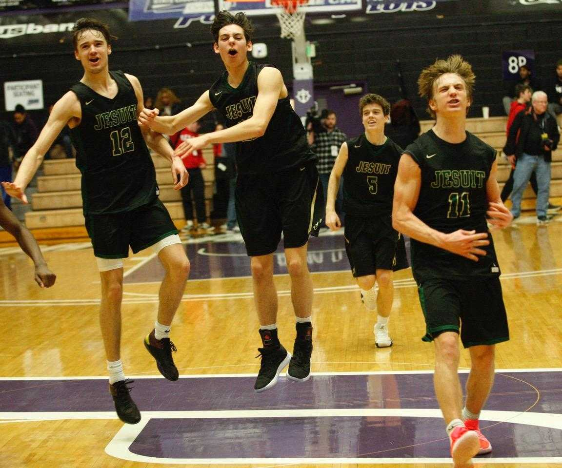 Jesuit players celebrate after defeating Lake Oswego in a 6A semifinal Friday. (Photo by Norm Maves Jr.)
