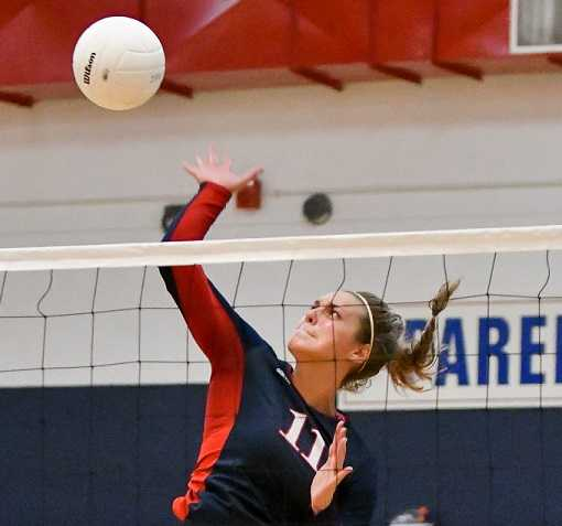 Kennedy's Sophia Carley attacks against Salem Academy. (Photo by Andre Panse)