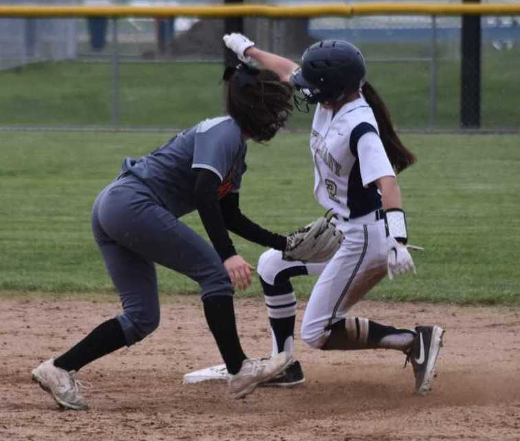 West Albany's Presley Jantzi, sliding under a tag at second base, had three hits Friday. (Photo by Jeremy McDonald)