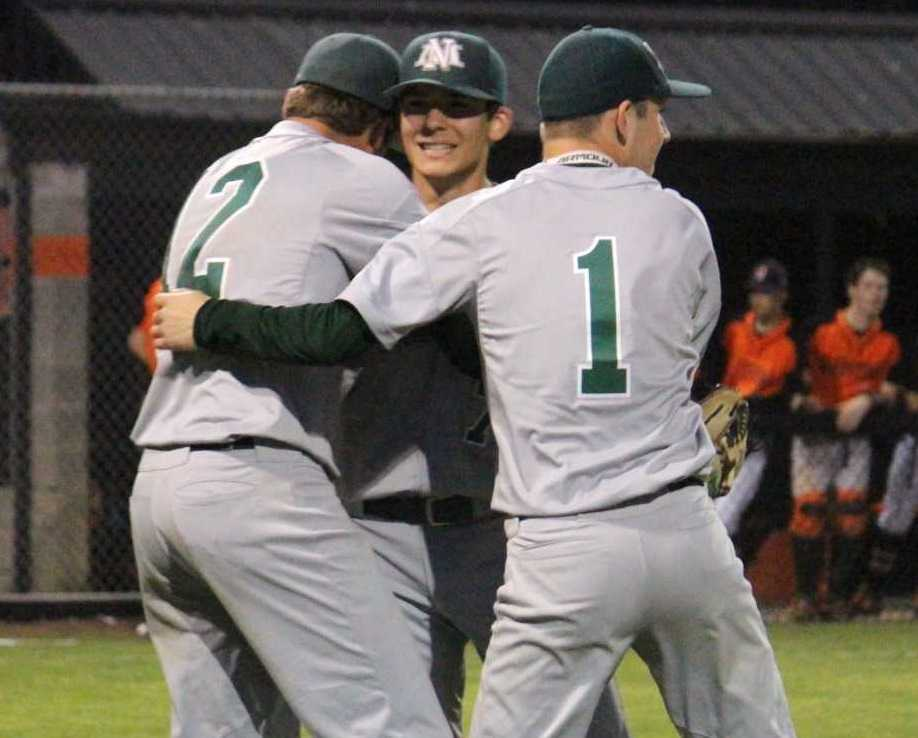 North Marion's Noah Wierstra (12) and Ryan Olson (1) celebrate with Grant Henry after beating Gladstone. (Photo by Anna Iliyn)