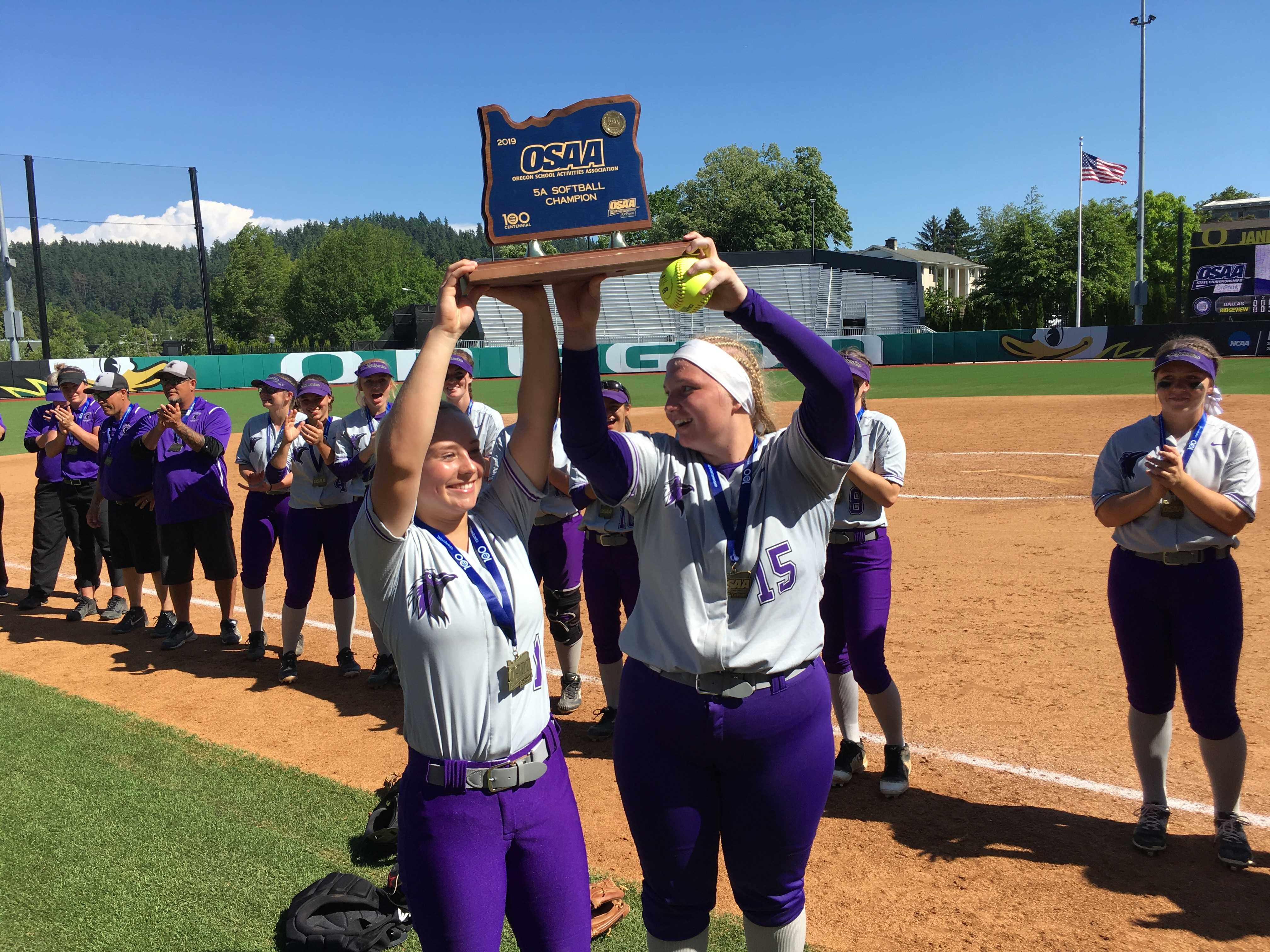 Sage McVay (left) and Allicitie Frost hoist Ridgeview's first state championship trophy.