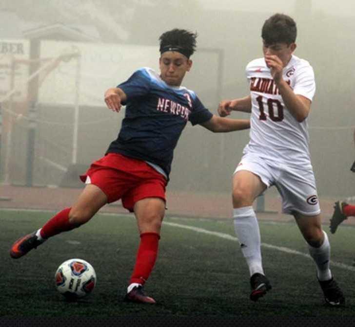 Newport's Kevin Teodoro works against Gladstone's Logan Greco (10) last season. (Photo by Robert Smith)