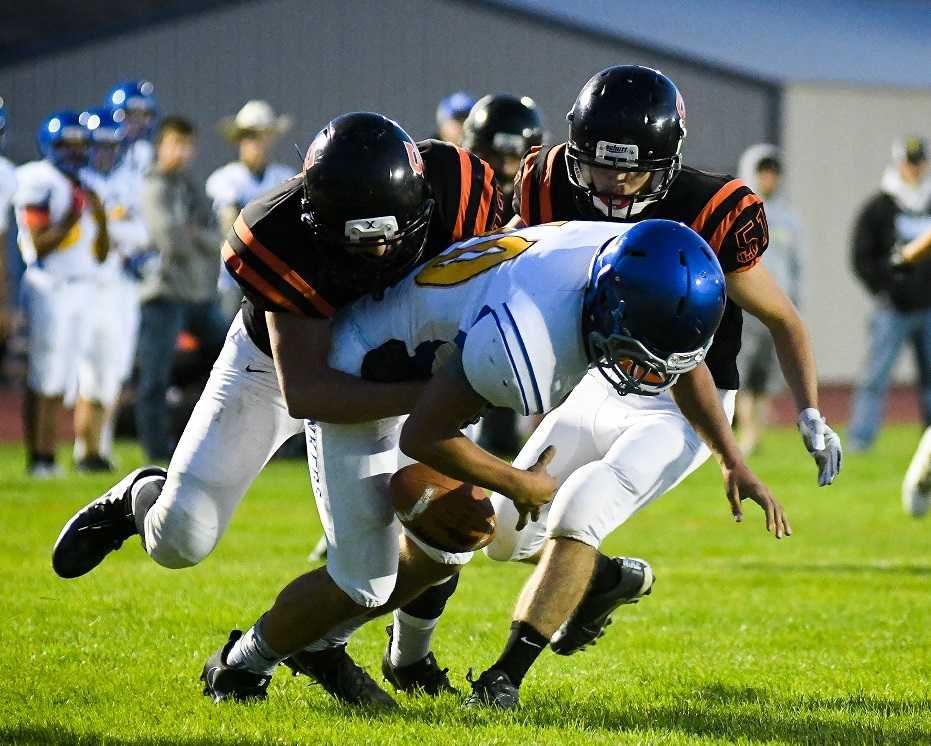 Sherman, in black, will co-op with Condon for a six-man team this season. (Photo by Jeremy Lanthorn)