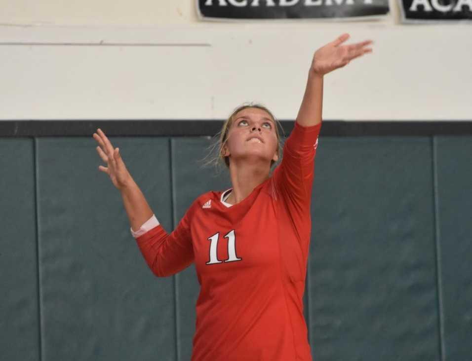Kennedy's Sophia Carley serves against Salem Academy on Tuesday. (Photo by Jeremy McDonald)