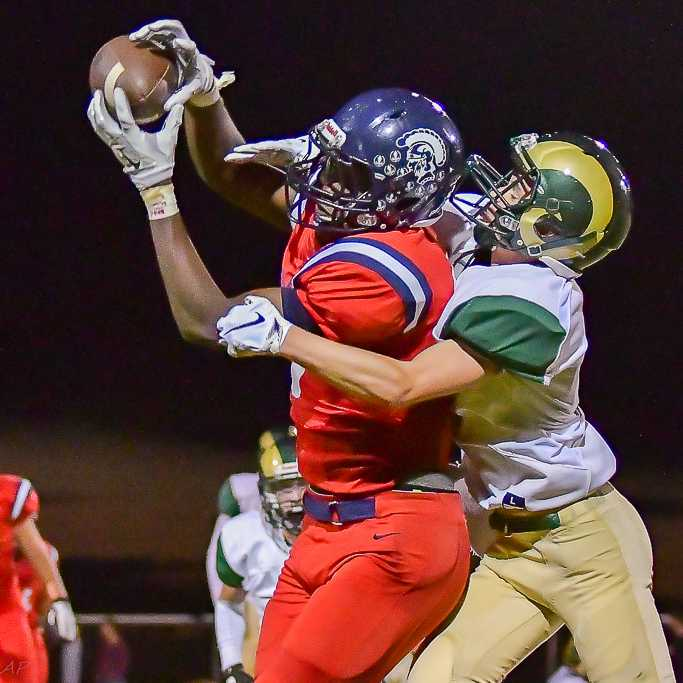 Kennedy's Emorej Lynk, intercepting a pass, scored four touchdowns against Regis. (Photo by Andre Panse)