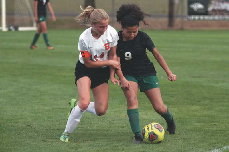 Scappoose is off to a strong start in 2019 with Emma Jones (left) leading the way. Photo by Phil Hawkins