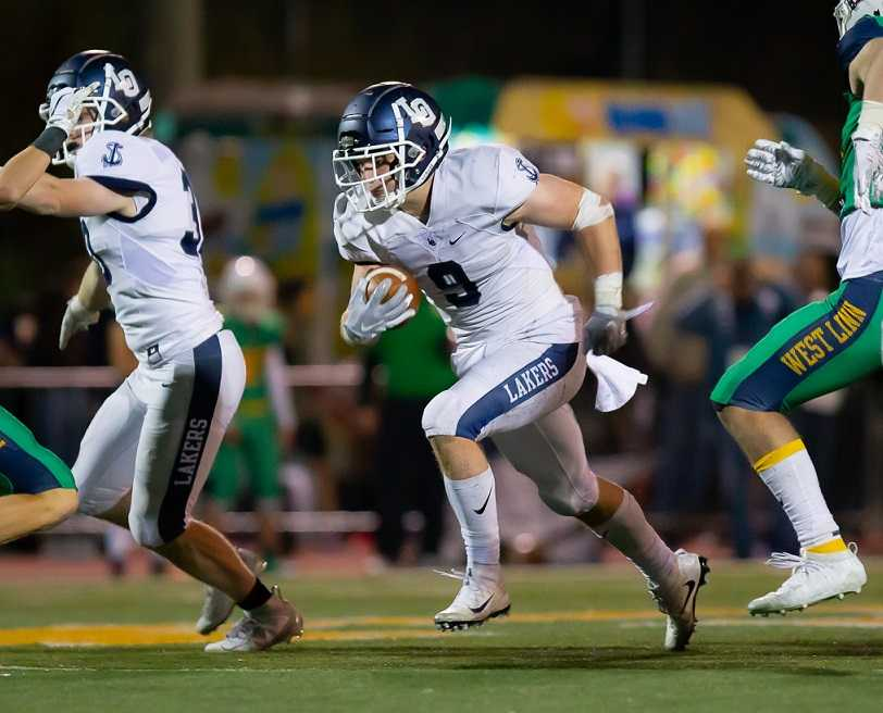 Senior Casey Filkins rushed for 180 yards and two touchdowns Friday at West Linn. (Photo by Brad Cantor)