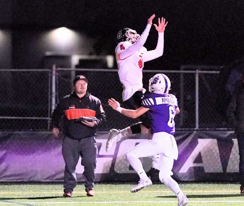 Beaverton's Trent Walker goes up for a pass against Sunset's Kyle Jaekel (6). (Photo by Jon Olson)
