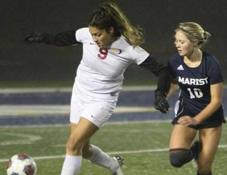 Ontario's Iris Meza (9) battles with Marist Catholic's Whitney Korth (10) on Tuesday. (Photo by Kevin Cave)