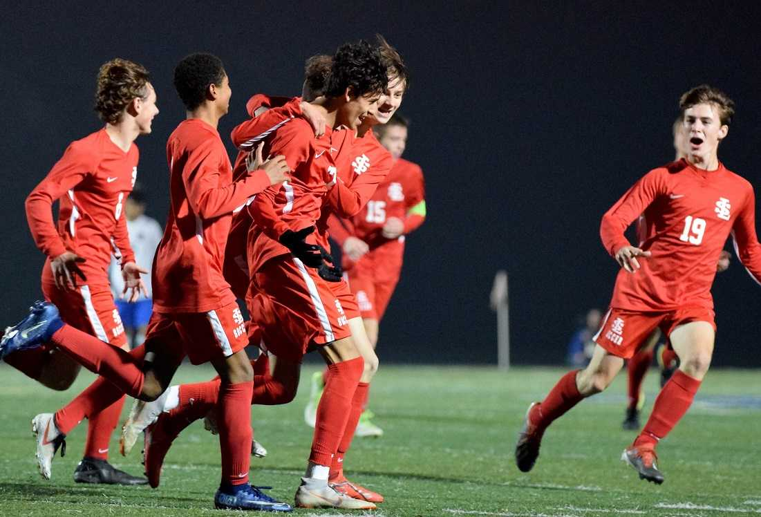 La Salle Prep players celebrate with Manny Arredondo after his second-half goal Tuesday. (Photo by Lauren Craven)