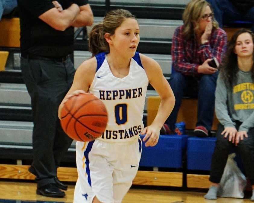 Madelyn Nichols brings the ball upcourt for the Heppner Mustangs