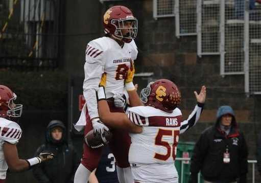 Central Catholic's Silas Starr celebrates his touchdown catch in Saturday's 49-28 win over Lake Oswego. (Norm Maves Jr.)