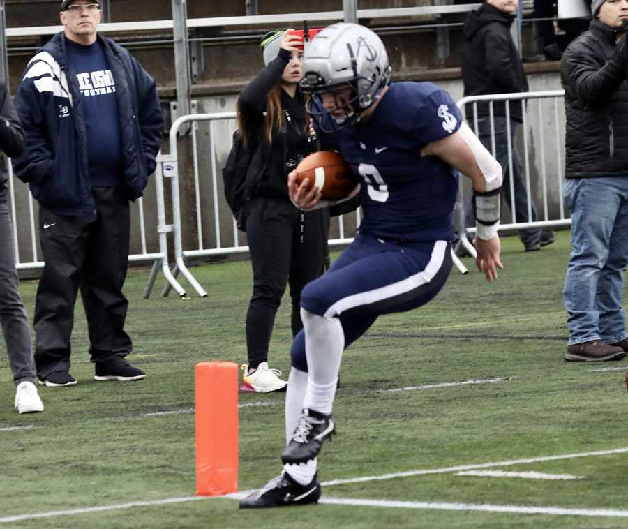 Lake Oswego's Casey Filkins crosses the goalline, both in the final and on his career as a Laker. Photo by Norm Maves