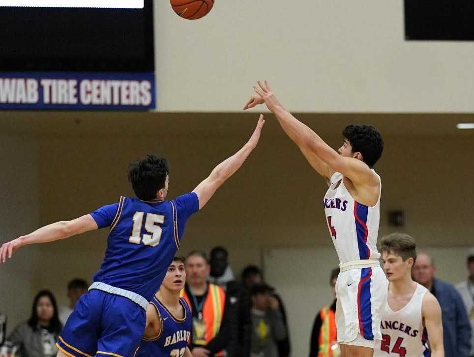 Churchill's Silas Bennion connects on the game-winning three-pointer over Barlow's Jesse White on Thursday. (Photo by Jon Olson)