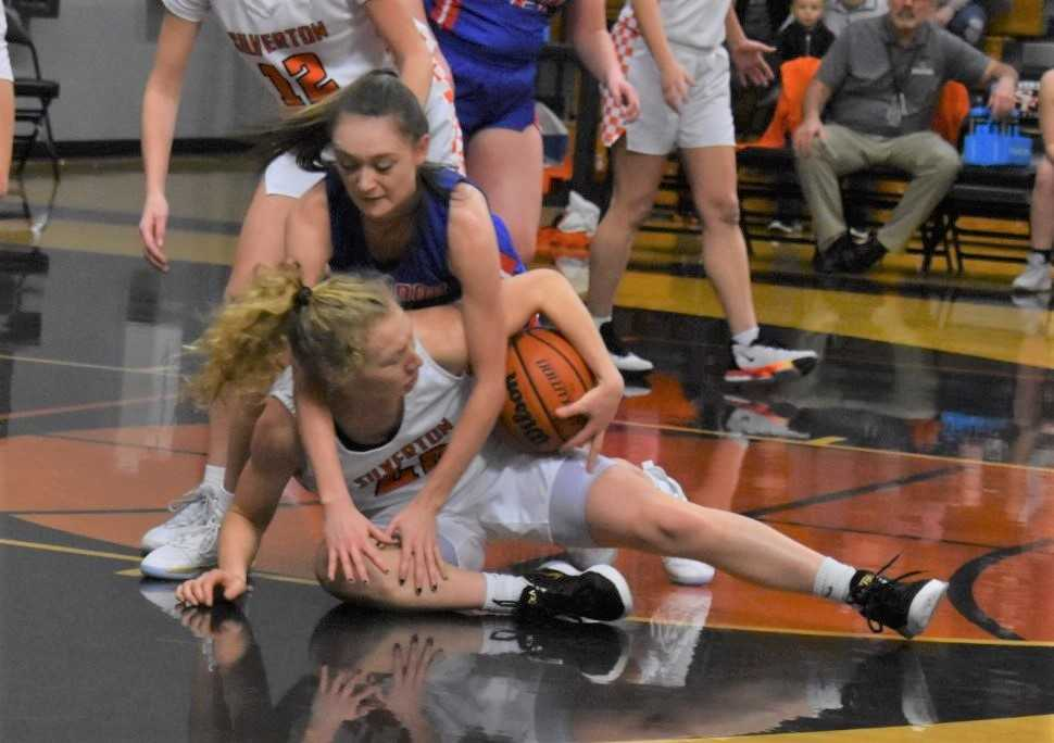 Silverton's Ellie Schmitz (white) goes on the floor for a loose ball Tuesday against Lebanon. (Photo by Jeremy McDonald)