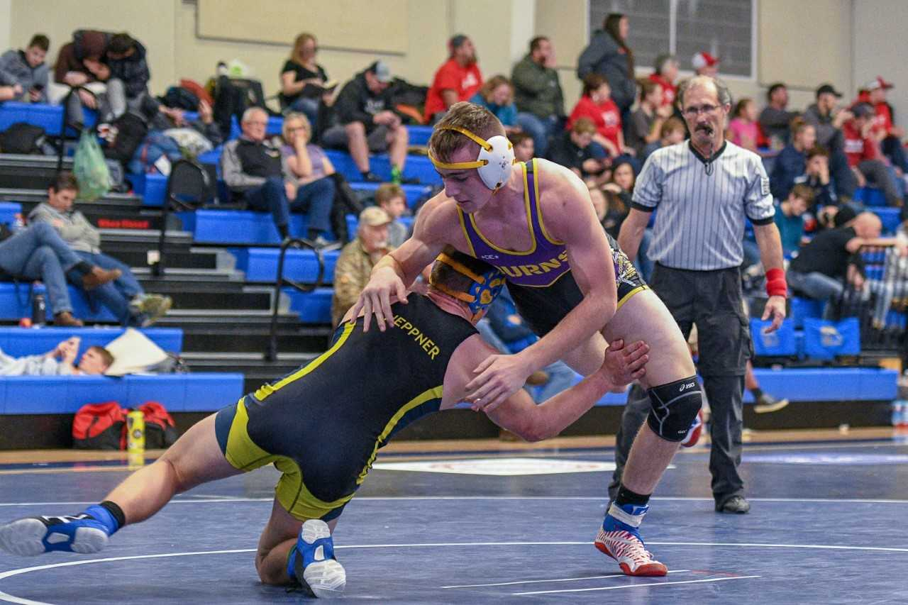 Senior Anthony Moulton (right)  is one of six state placers back for Burns. (Kirsti Cason/Eastern Oregon Sports Photos)