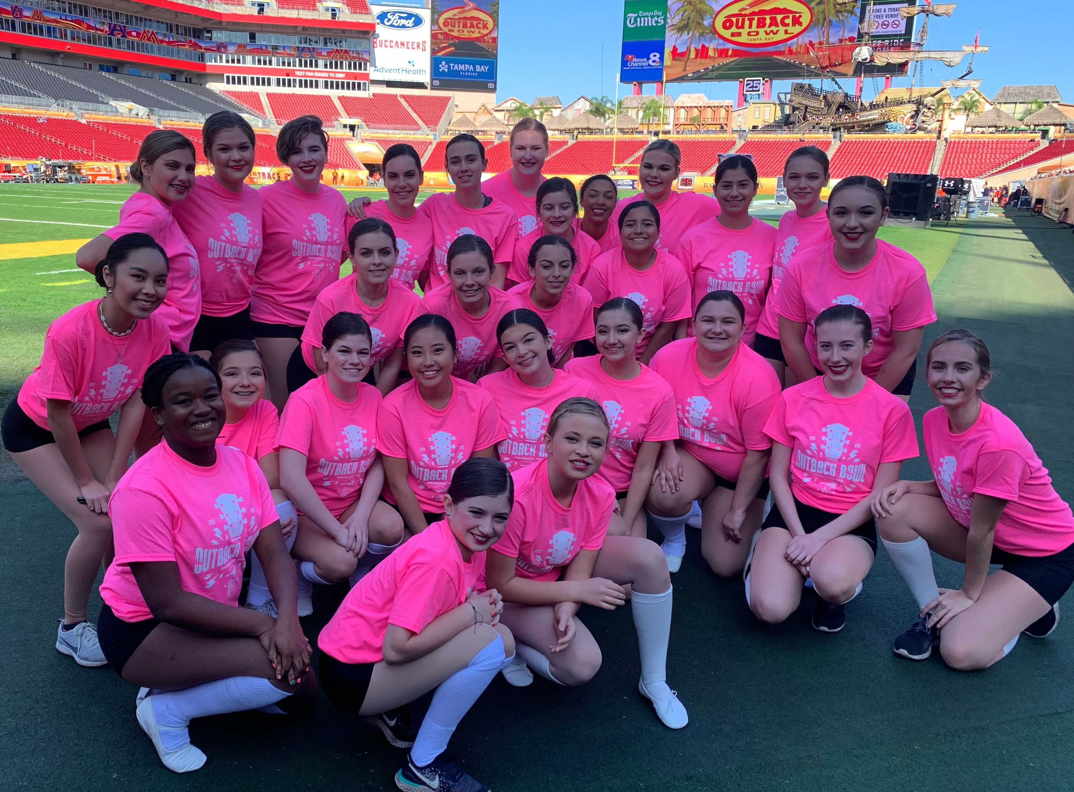 Oregon dancers get ready for their performance at the 2020 Outback Bowl.