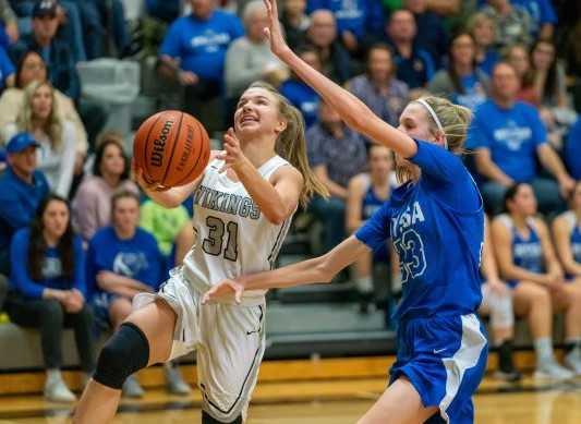 Vale's Ashley Jacobs drives against Nyssa's Gracie Johnson on Saturday. (Randy Seals/Eastern Oregon Sports Photos)
