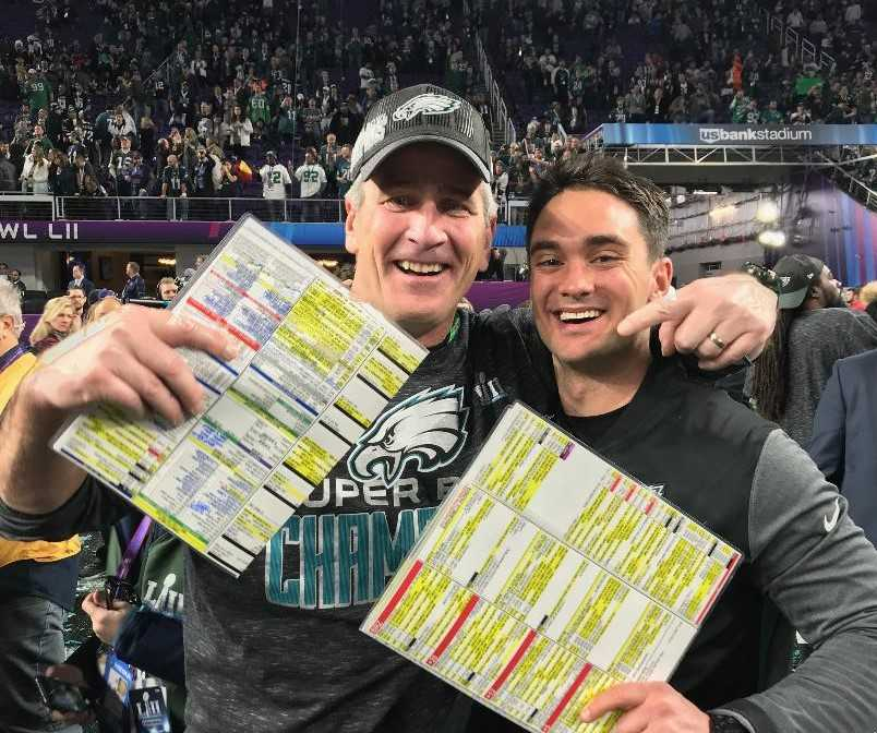 Spencer Phillips (right) with assistant Frank Reich after Philadelphia won the Super Bowl. (Samantha Wood/Philadelphia Eagles)